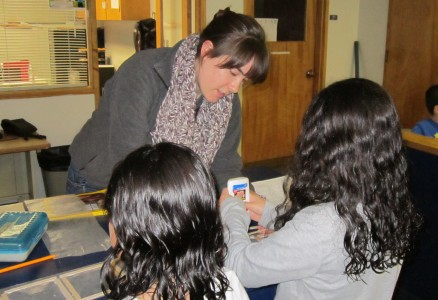 JV AmeriCorps Member Julia Krolikowski helps with an art project at the YMCA