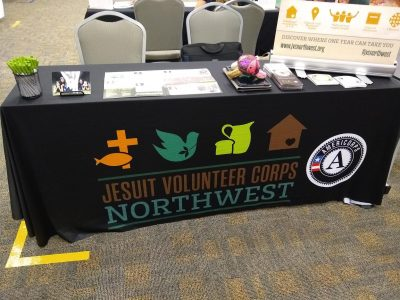 Table with a JVC Northwest cloth