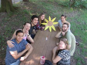 People smiling at a picnic table