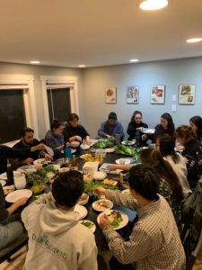 people eating family style at a table