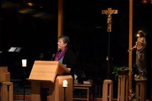 woman speaking at church altar