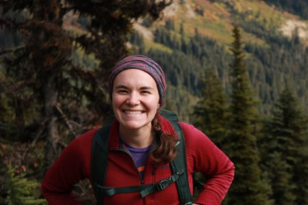 woman smiling forest in background